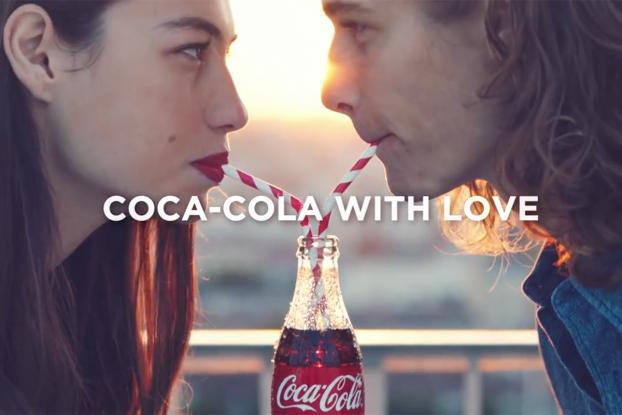 coke replaces open happiness with taste the feeling adage