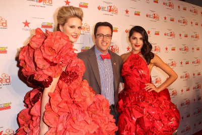 Jared Fogle with Subway ambassadors in dresses made solely of Subway napkins and wrappers at the Go Red for Women The Heart Truth Red Dress Collection 2014.