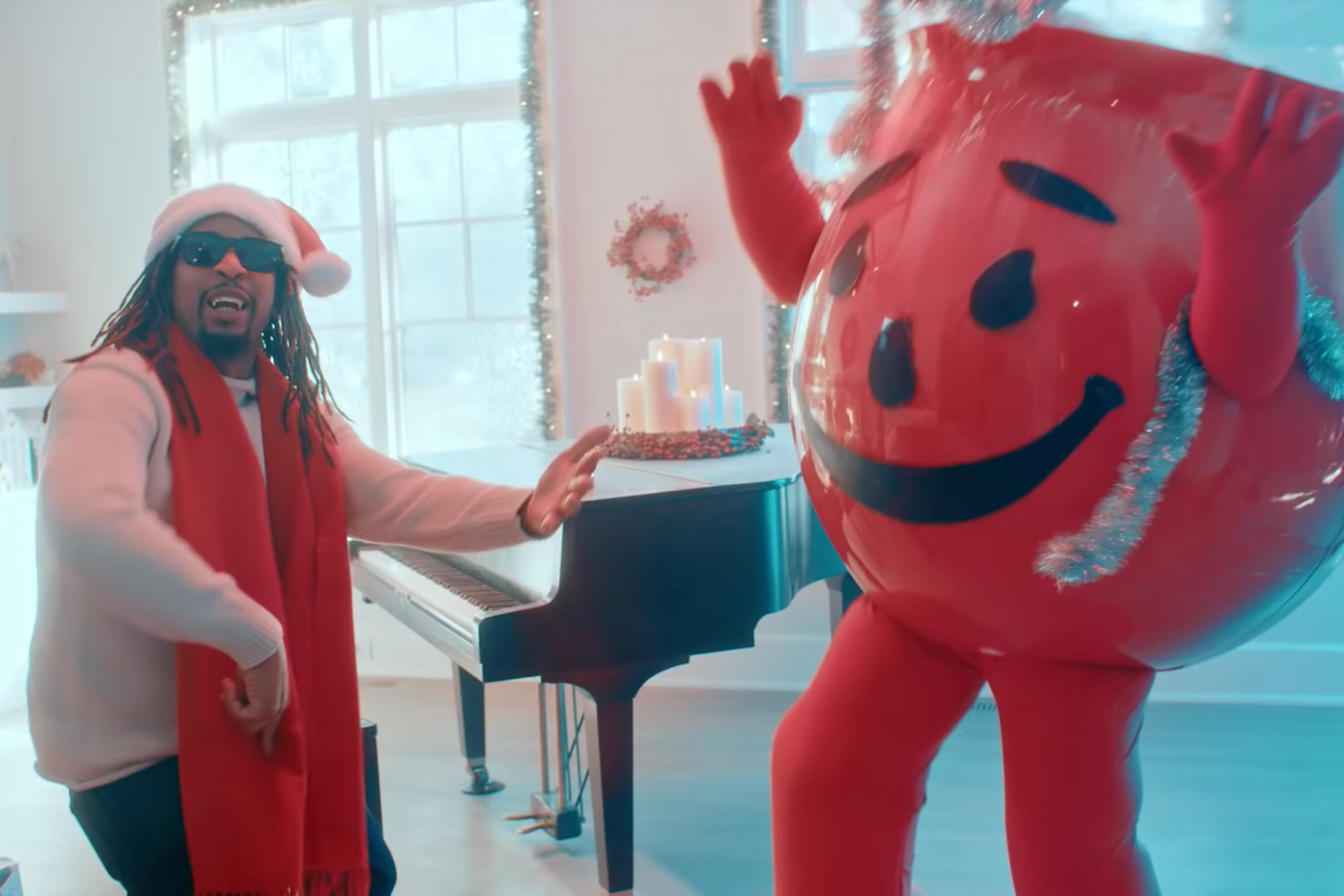Lil Jon and the Kool-Aid Man bust walls in a holiday rap duet